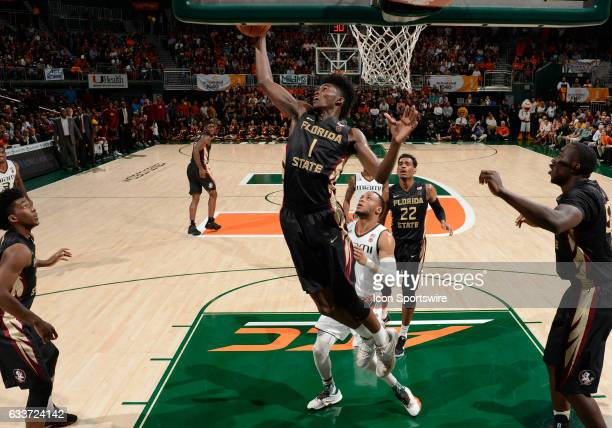 Florida State forward Jonathan Isaac grabs a rebound during a college basketball game between the Florida State University Seminoles and the...