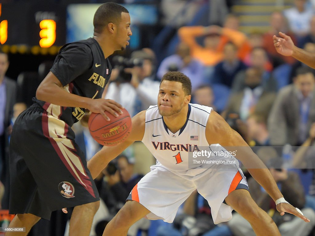 Florida State guard Devon Bookert left is guarded by Virginia guard Justin Anderson during the University of Virginia's defeat of 58 44 Florida State...