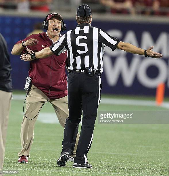 Florida State head coach Jimbo Fisher argues with side judge Gene Semko during the Florida State vs University of Mississippi college football game...