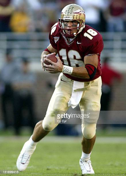 Florida State Quarterback Chris Rix scrambles out of the pocket during the first half against North Carolina State University at Doak Stadium in...
