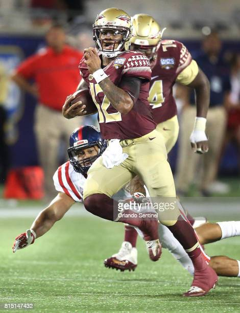 Florida State quarterback Deondre Francois scrambles for a first down during the Florida State vs University of Mississippi college football game on...