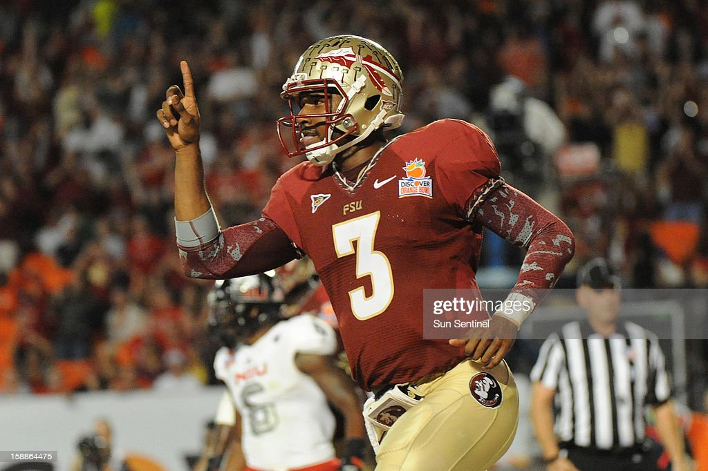 Florida State quarterback EJ Manuel celebrates his touchdown against Northern Illinois during the second half of the Discover Orange Bowl on Tuesday, January 1, 2013, in Miami Gardens, Florida.