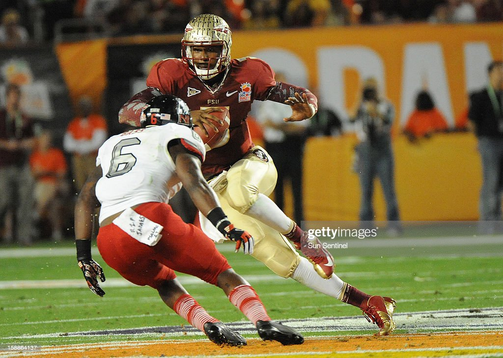 Florida State quarterback EJ Manuel evades Northern Illinois Jamaal Bass during the Discover Orange Bowl on Tuesday, January 1, 2013, in Miami Gardens, Florida.