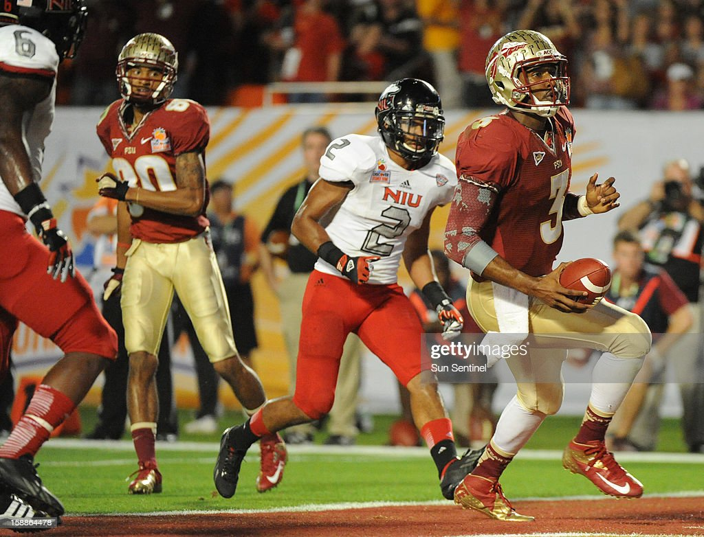 Florida State quarterback EJ Manuel scores a touchdown past Northern Illinois cornerback Sean Evans during the second half of the Discover Orange Bowl on Tuesday, January 1, 2013, in Miami Gardens, Florida.