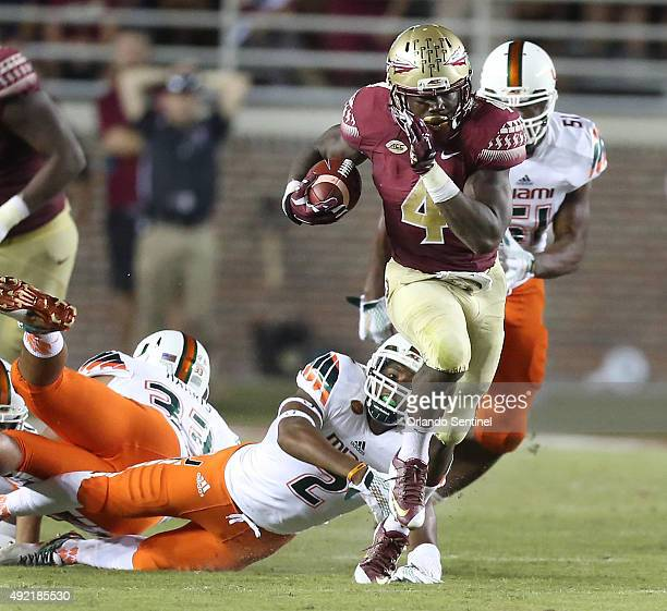 Florida State running back Dalvin Cook runs away from Miami defenders at Doak Campbell Stadium in Tallahassee Fla on Saturday Oct 10 2015