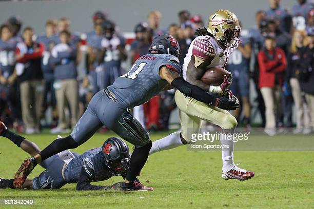 Florida State running back Dalvin Cook runs the ball with NC State safety Josh Jones making the tackle during the second half between the Florida...