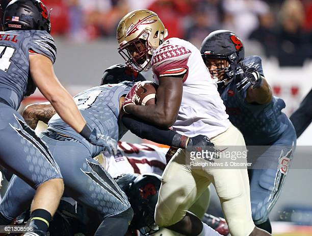 Florida State running back Jacques Patrick beats NC State safety Josh Jones to score on a 2yard touchdown run during the first half at CarterFinley...