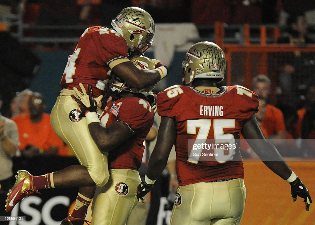 Florida State running back Lonnie Pryor celebrates his 60-yard touchdown against Northern Illinois with teammate Chad Abram during the first half of the Discover Orange Bowl on Tuesday, January 1, 2013, in Miami Gardens, Florida.