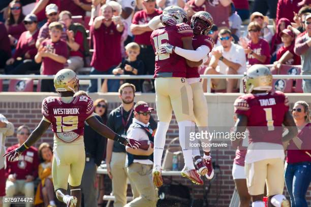 Florida State Seminoles defensive back Tarvarus McFadden celebrates with Florida State Seminoles linebacker Jacob Pugh following a blocked kick...