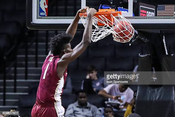 Florida State Seminoles forward Jonathan Isaac dunks during the second half of the NIT Season TipOff NCAA Mens basketball game between the Florida...