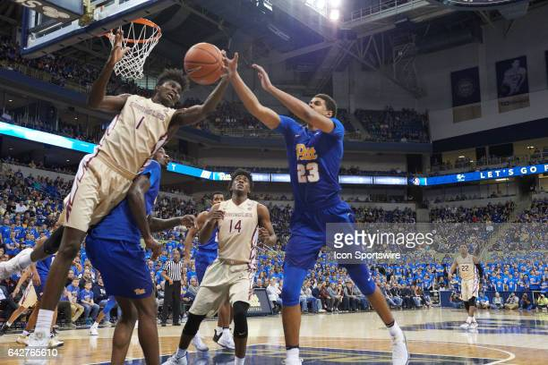 Florida State Seminoles forward Jonathan Isaac grabs the rebound from Pittsburgh Panthers guard Cameron Johnson during a basketball game between...