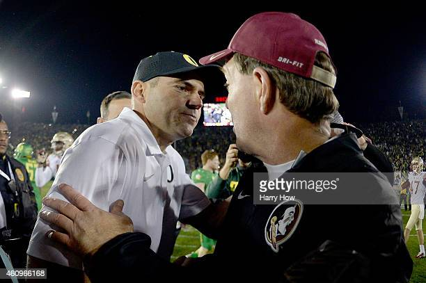 Florida State Seminoles head coach Jimbo Fisher congratulates Oregon Ducks head coach Mark Helfrich on his win following the College Football Playoff...