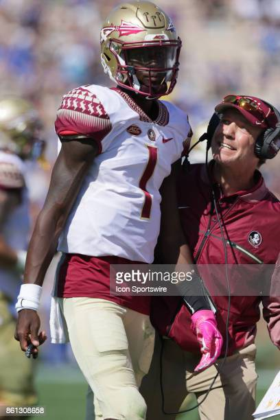 Florida State Seminoles head coach Jimbo Fisher talks to quarterback James Blackman after failing to complete a first down in the first half on...