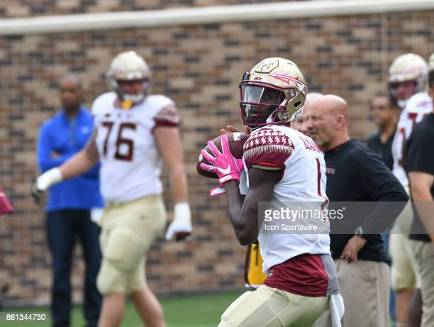 Florida State Seminoles quarterback James Blackman sets for the pass during a college football game between the Florida State Seminoles and the Duke...