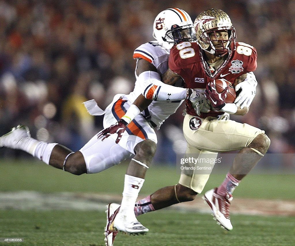Florida State Seminoles wide receiver <a gi-track='captionPersonalityLinkClicked' href=/galleries/search?phrase=Rashad+Greene+-+American+Football+Player&family=editorial&specificpeople=13970375 ng-click='$event.stopPropagation()'>Rashad Greene</a> (80) makes a catch against Auburn Tigers cornerback <a gi-track='captionPersonalityLinkClicked' href=/galleries/search?phrase=Chris+Davis+-+American+Football+Cornerback&family=editorial&specificpeople=15200244 ng-click='$event.stopPropagation()'>Chris Davis</a> (11) during the BCS National Championship game at the Rose Bowl in Pasadena, Calif., on Monday, Jan. 6, 2014.