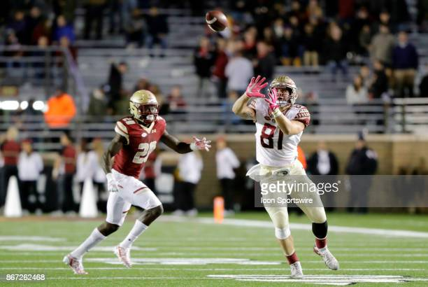 Florida State tight end Ryan Izzo looks for the recption as Boston College defensive back Isaac Yiadom moves in during a game between the Boston...