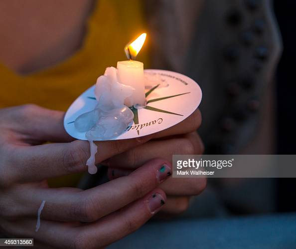 Florida State University student holds a candle during the Gathering of Unity candlelight vigil on campus after the shooting of three FSU students...
