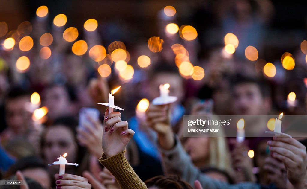 Florida State University students hold their candles aloft during the Gathering of Unity candlelight vigil on campus after the shooting of three FSU...