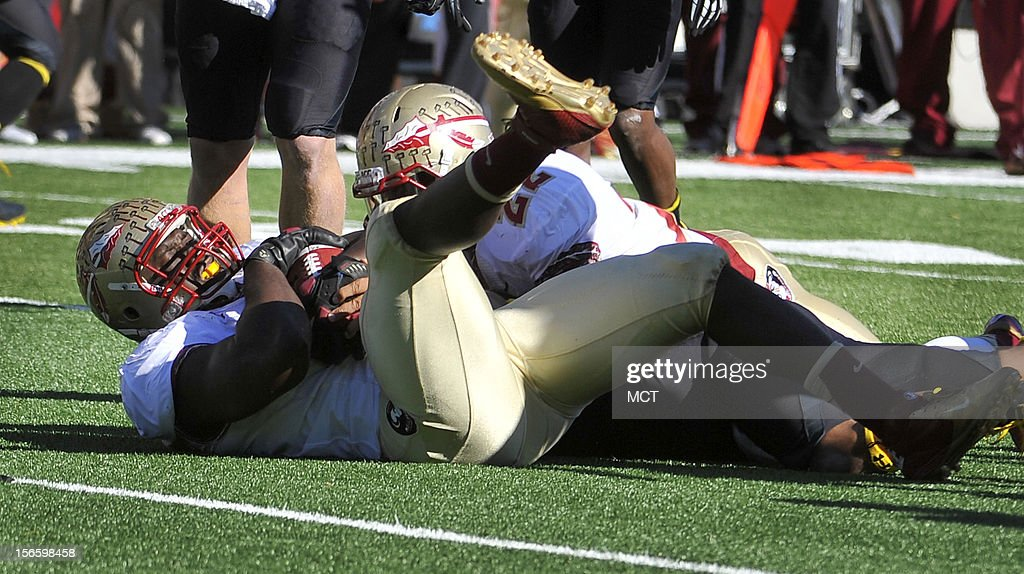 Florida State's Cornellius Carradine recovers a fumble by Maryland quarterback Shawn Petty in the 1st quarter at Byrd Stadium in College Park, Maryland, on Saturday, November 17, 2012. The Florida State Seminoles defeated the Maryland Terrapins, 41-14.