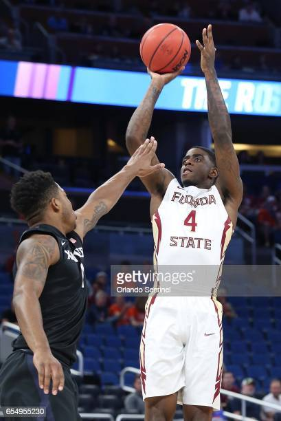 Florida State's Dwayne Bacon shoots over Xavier's Tyrique Jones in the second round of the NCAA Tournament at the Amway Center in Orlando Fla on...