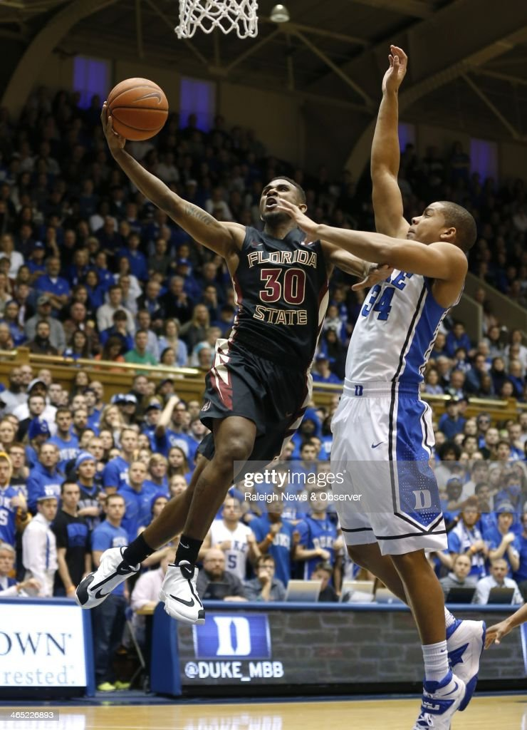 Florida State's Ian Miller (30) drives in for two while drawing a foul on Duke's Andre Dawkins (34) during the first half at Cameron Indoor Stadium in Durham, N.C., Saturday, Jan. 25, 2014. Duke defeatedFSU, 78-56.