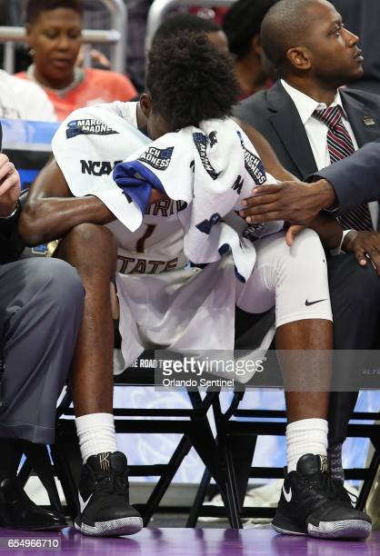Florida State's Jonathan Isaac is dejected on the bunch against Xavier in the second round of the NCAA Tournament at the Amway Center in Orlando Fla...