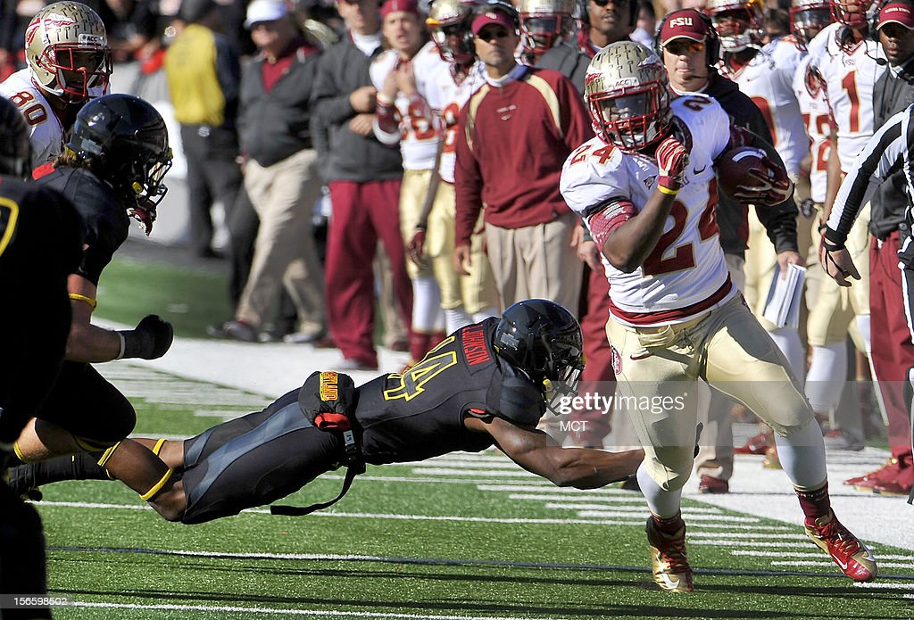 Florida State's Lonnie Pryor slips past Maryland's Jeremiah Johnson in the 2nd quarter at Byrd Stadium in College Park, Maryland, on Saturday, November 17, 2012. The Florida State Seminoles defeated the Maryland Terrapins, 41-14.