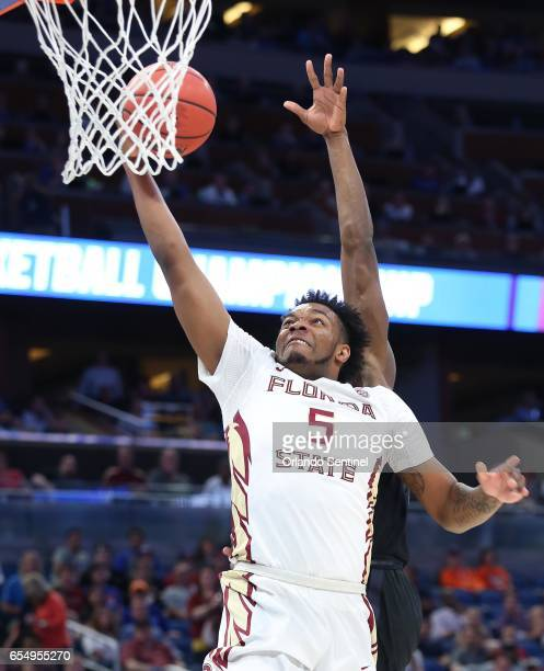 Florida State's PJ Savoy is fouled from behind as he scores against Xavier in the second round of the NCAA Tournament at the Amway Center in Orlando...