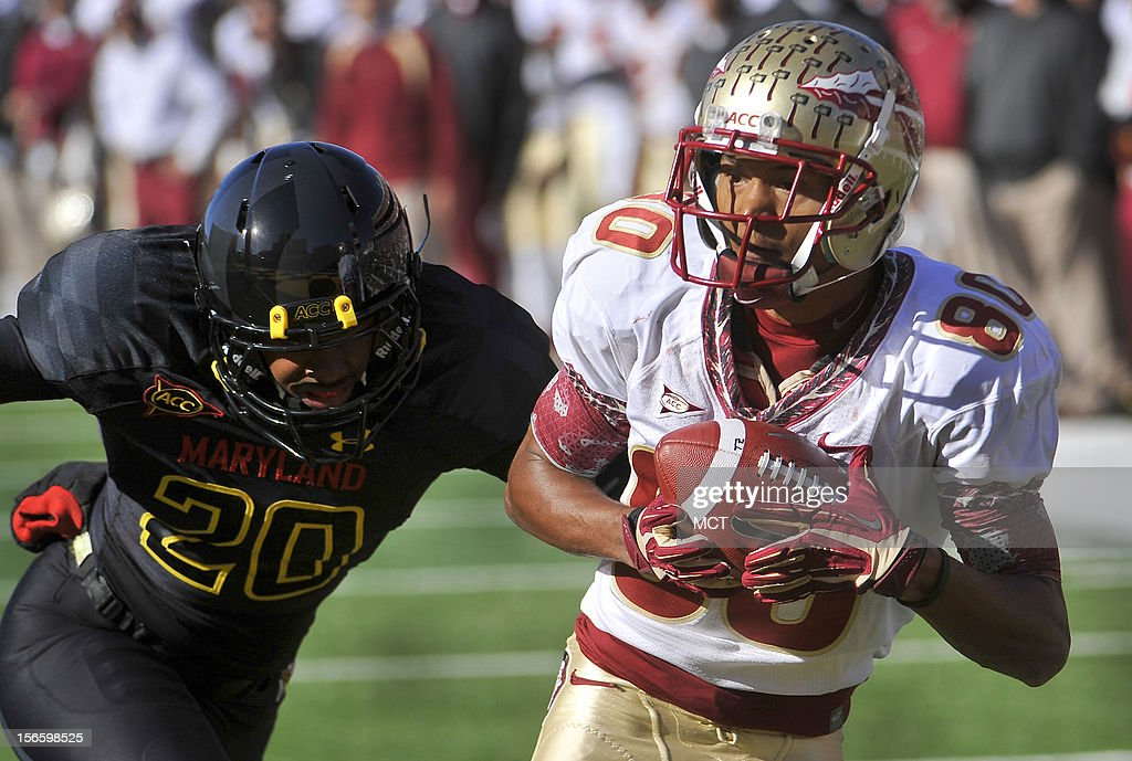 Florida State's Rashad Greene catches a pass in front of Maryland's Anthony Nixon and runs 30 yards for a touchdown at Byrd Stadium in College Park, Maryland, on Saturday, November 17, 2012. The Florida State Seminoles defeated the Maryland Terrapins, 41-14.