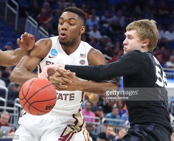 Florida State's Trent Forrest left loses the ball to Xavier's JP Macura in the second round of the NCAA Tournament at the Amway Center in Orlando Fla...