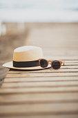 USA, Florida, Straw hat and sunglasses on beach