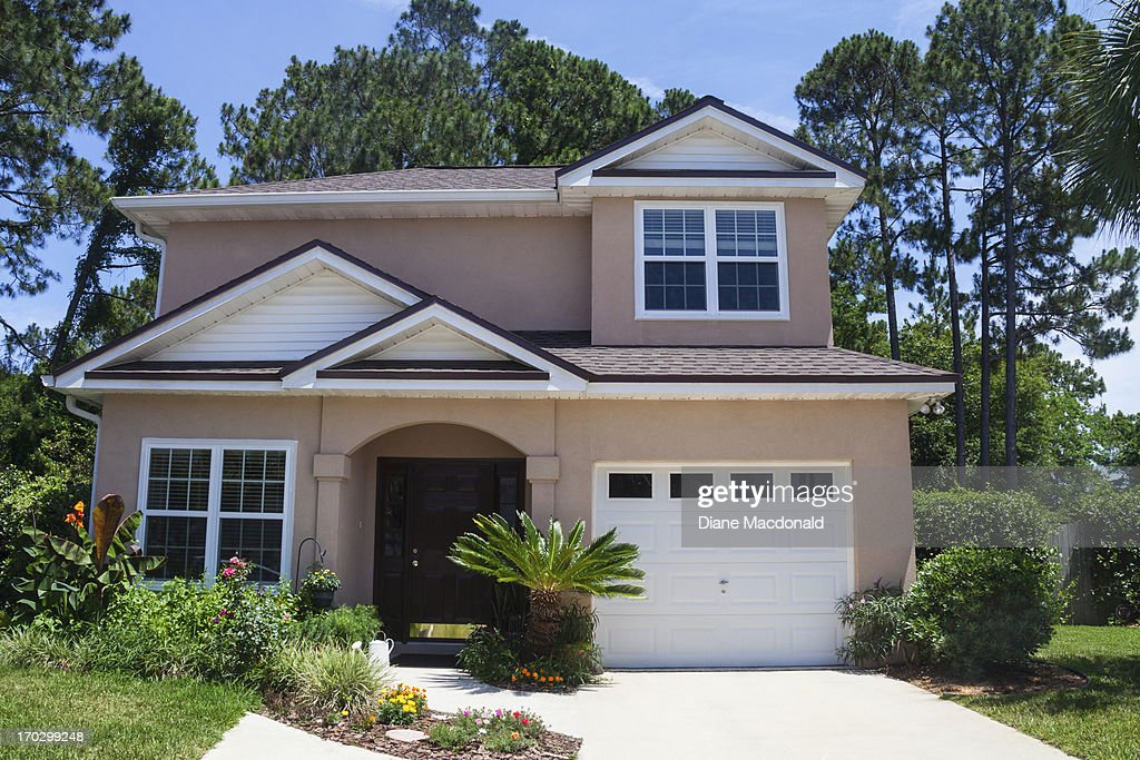 a florida stucco house in a beach community stock photo