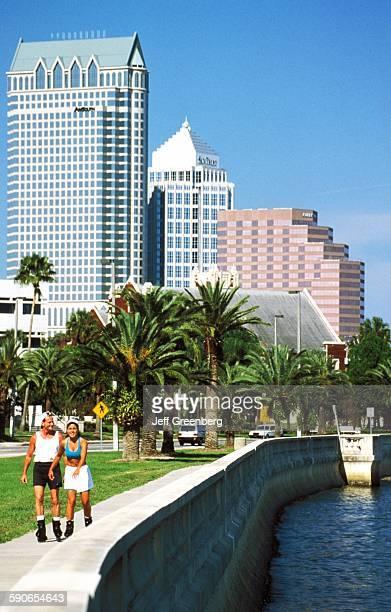 Florida Tampa Bayshore Boulevard Rollerbladers With City Skyline Beyond