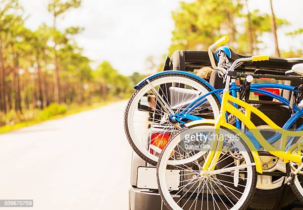 USA, Florida, Tequesta, Couple in car with bike rack