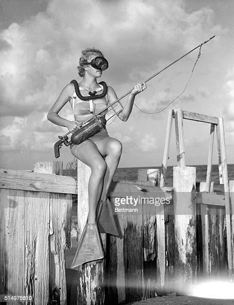 Florida This is how a fish hunter looks just before she sets out for big game Dolores Medlin checks her gas gun and spear She's all decked out with...