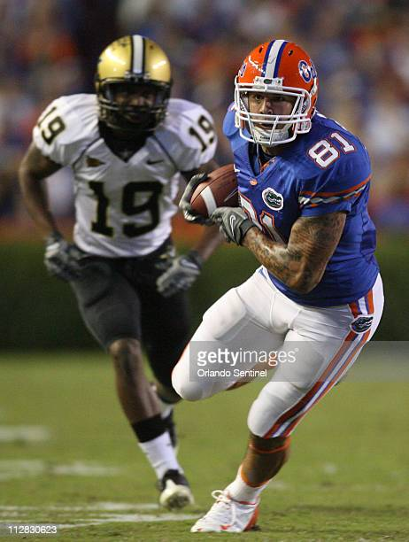 Florida tight end Aaron Hernandez completes a reception for a first down against Vanderbilt during the first quarter of play at Ben Hill Griffin...