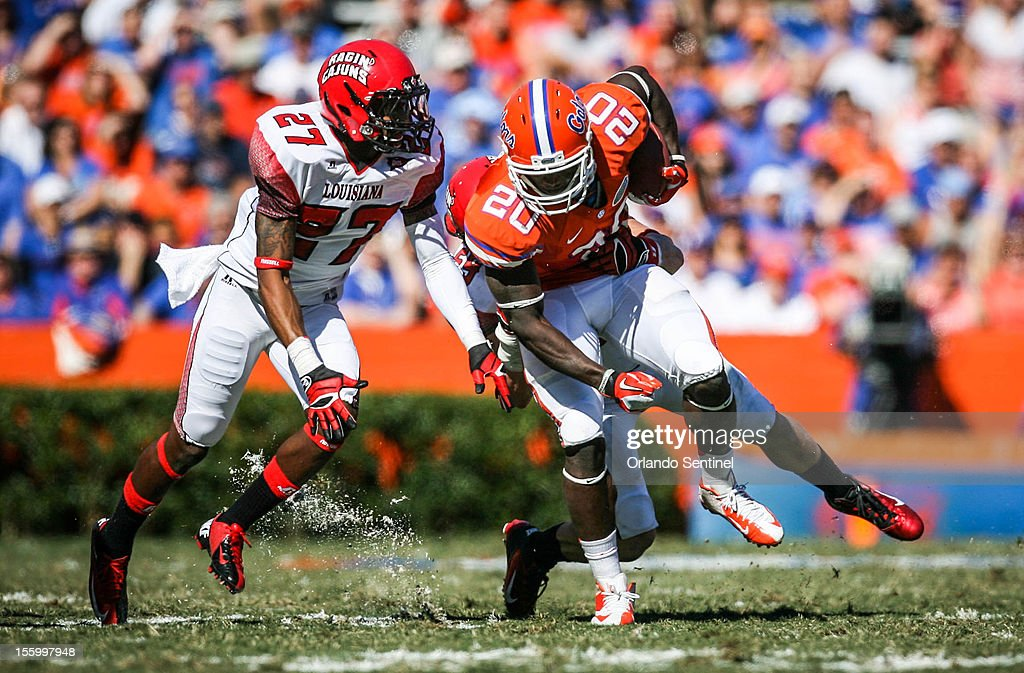 Florida tight end Omarius Hines (20) runs for yardage during second-quarter action against Louisiana-Lafayette at Ben Hill Griffin Stadium on Saturday, November 10, 2012, in Gainesville, Florida. The host Gators rallied for a 27-20 win.