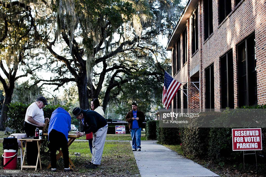 Florida voters fill out an exit poll after voting in the state's Republican party primary on January 31, 2012 at the Micanopy Town Hall in Micanopy, Fla. After a decisive South Carolina win, former House speaker Newt Gingrich has risen and fallen in the polls and trails former Massachusetts Gov. Mitt Romney by double digits going in to Florida's primary.
