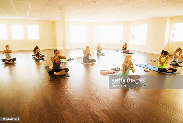 USA, Florida, West Palm Beach, Women exercising yoga