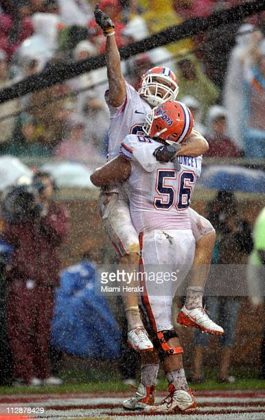 Florida's Aaron Hernandez and Mike Pouncey celebrate a first quarter touchdown reception against Florida State Florida defeated Florida State 3815 at...