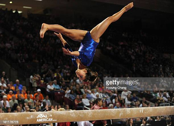 Florida's Alaina Johnson catches the air on the beam during 2011 NCAA gymnastics regional championship at Magness Arena of University of Denver on...