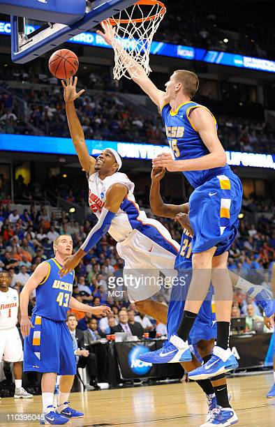 Florida's Alex Tyus takes a shot on UC Santa Barbara's Greg Somogyi during secondhalf action in the second round of the men's NCAA basketball...