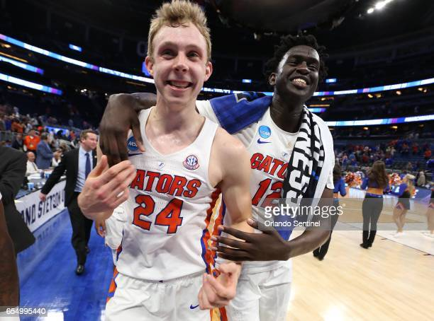Florida's Canyon Barry and Gorjok Gak celebrate after a 6539 win against Virginia during the second round of the NCAA Tournament at the Amway Center...