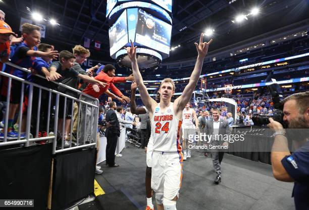 Florida's Canyon Barry celebrates after a 6539 win against Virginia during the second round of the NCAA Tournament at the Amway Center in Orlando Fla...