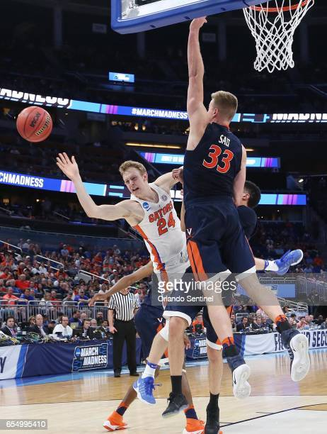 Florida's Canyon Barry is fouled by Virginia's jack Salt during the second round of the NCAA Tournament at the Amway Center in Orlando Fla on...