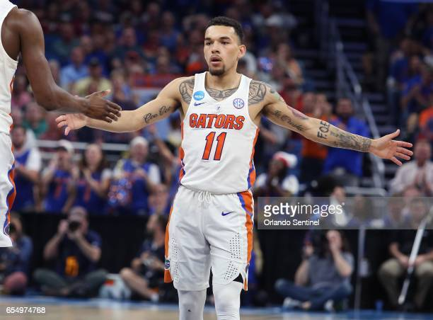 Florida's Chris Chiozza celebrates during action against Virginia during the second round of the NCAA Tournament at the Amway Center in Orlando Fla...