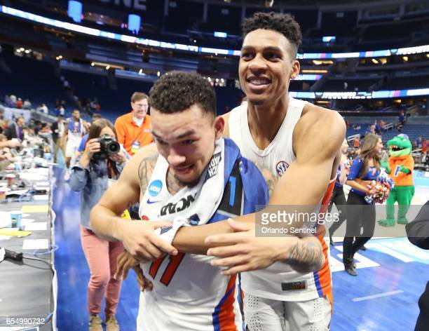 Florida's Chris Chiozza left and Devin Robinson right celebrate after a 6539 win against Virginia during the second round of the NCAA Tournament at...