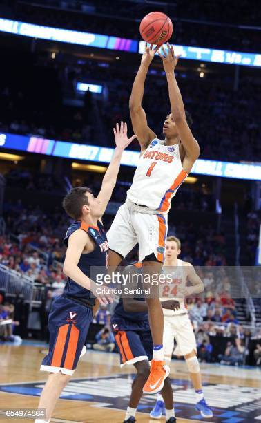 Florida's Devin Robinson shoots against Virginia during the second round of the NCAA Tournament at the Amway Center in Orlando Fla on Saturday March...