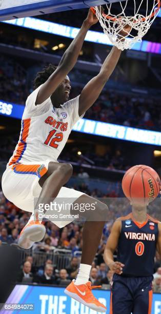 Florida's Gorjok Gak dunks against Virginia during the second round of the NCAA Tournament at the Amway Center in Orlando Fla on Saturday March 18...
