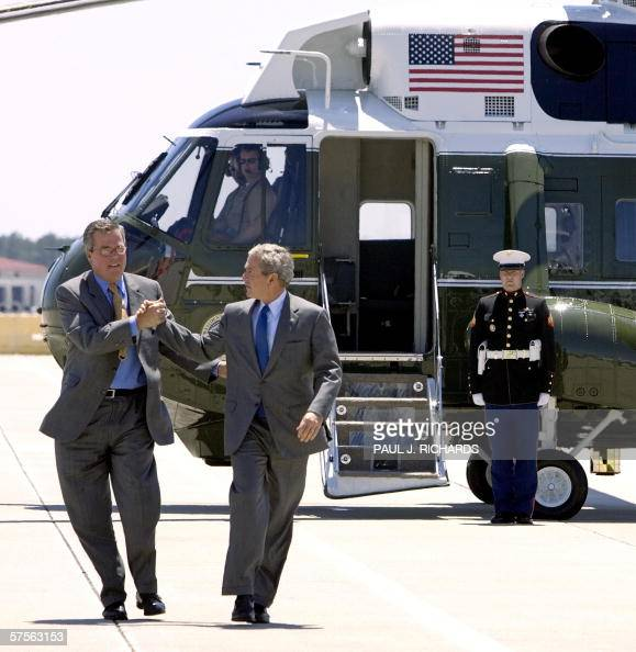 Florida's Governor Jeb Bush shakes hands with his brother President George W Bush as they step off Marine One at MacDill Air Force Base Florida 09...